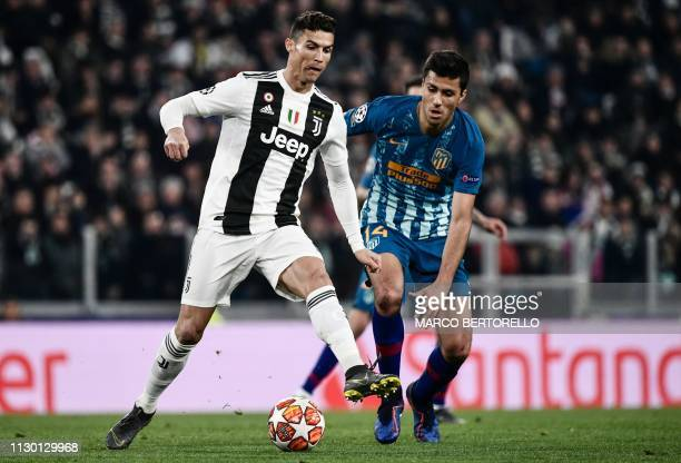 Juventus' Portuguese forward Cristiano Ronaldo outruns Atletico Madrid's Spanish midfielder Rodrigo Hernandez during the UEFA Champions League round...