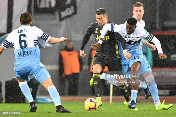 Juventus' Portuguese forward Cristiano Ronaldo outruns Lazio's Angolan defender Bastos during the italian Serie A football match Lazio Roma vs...