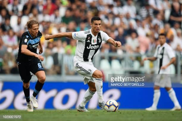 Juventus' Portuguese forward Cristiano Ronaldo outruns Lazio's Brazilian midfielder Lucas Leiva during the Italian Serie A football match Juventus vs...