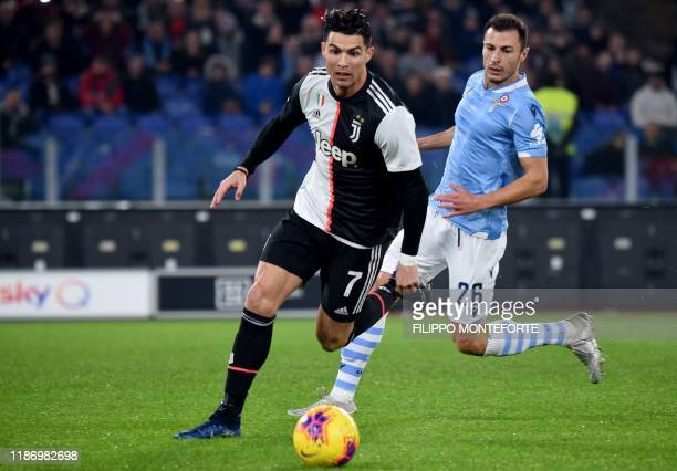 Juventus' Portuguese forward Cristiano Ronaldo outruns Lazio's Romanian defender Stefan Radu during the Italian Serie A football match lazio Rome vs...