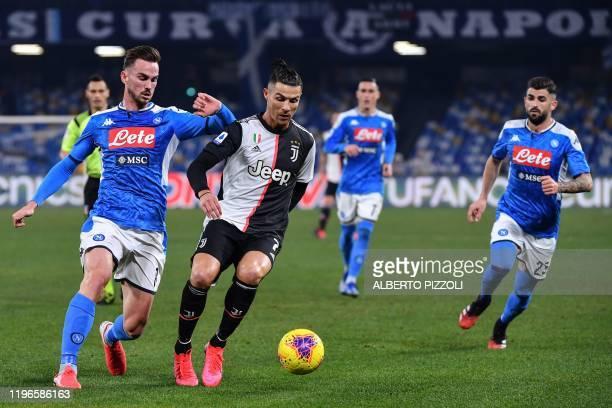Juventus' Portuguese forward Cristiano Ronaldo outruns Napoli's Spanish defender Fabian Ruiz during the Italian Serie A football match Napoli vs...