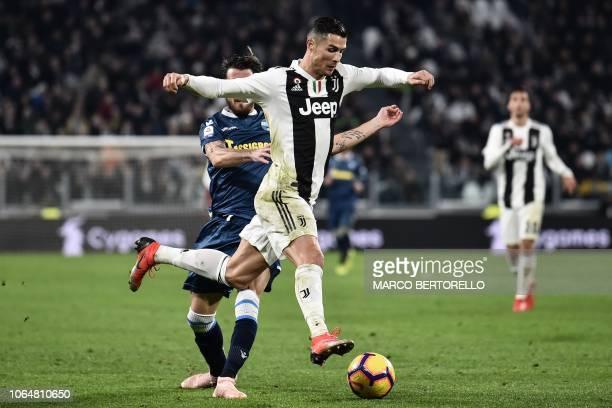 Juventus' Portuguese forward Cristiano Ronaldo outruns SPAL's Italian midfielder Mirko Valdifiori during the Italian Serie A football match Juventus...
