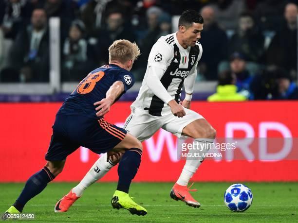 Juventus' Portuguese forward Cristiano Ronaldo outruns Valencia's Danish midfielder Daniel Wass during the UEFA Champions League group H football...