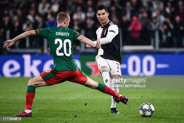 Juventus' Portuguese forward Cristiano Ronaldo passes the ball past Lokomotiv Moscow's Russian midfielder Vladislav Ignatyev during the UEFA...