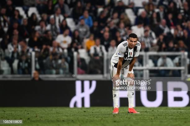 Juventus' Portuguese forward Cristiano Ronaldo pauses during the Italian Serie A football match Juventus vs Genoa on October 20 2018 at the Juventus...