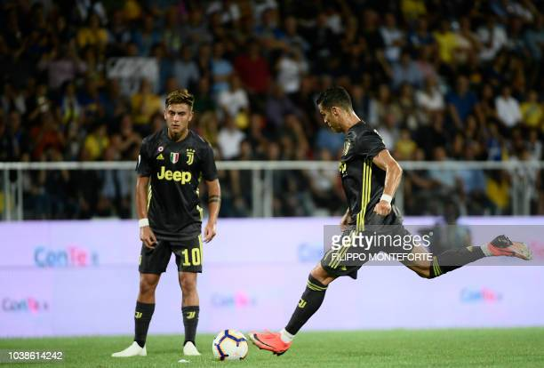 Juventus' Portuguese forward Cristiano Ronaldo plays a free kick during the Italian Serie A football match between Frosinone and Juventus Turin on...