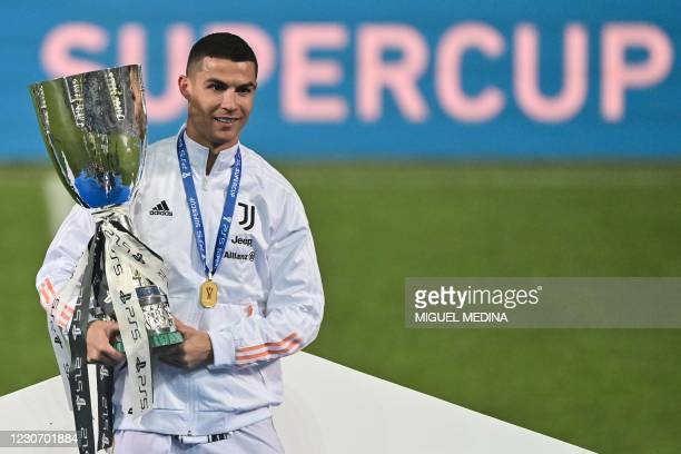 Juventus' Portuguese forward Cristiano Ronaldo poses with the winners' trophy after Juventus won the Italian Super Cup football match against Napoli...
