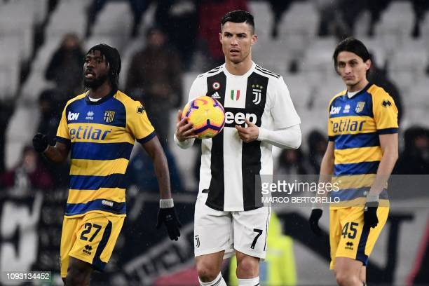 Juventus' Portuguese forward Cristiano Ronaldo prepares to kickoff after Parma scored 21 during the Italian Serie A football match Juventus vs Parma...