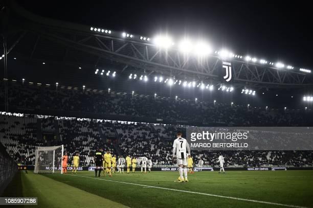 Juventus' Portuguese forward Cristiano Ronaldo prepares to shoot a free kick during the Italian Serie A football match Juventus vs Chievo Verona on...
