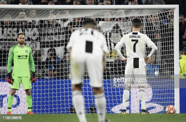 Juventus' Portuguese forward Cristiano Ronaldo prepares to shoot a penalty during the UEFA Champions League round of 16 secondleg football match...