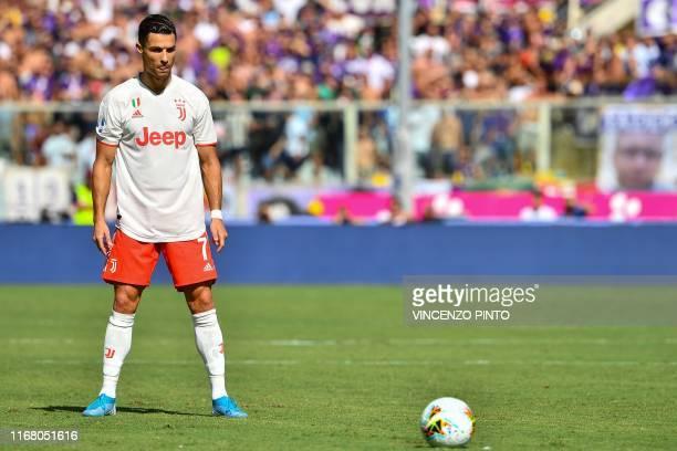 Juventus' Portuguese forward Cristiano Ronaldo prepares to shoot a free kick during the Italian Serie A football match Fiorentina vs Juventus on...