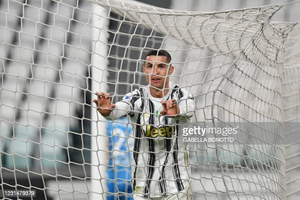 Juventus' Portuguese forward Cristiano Ronaldo reacts after a goal opportunity during the Italian Serie A football match Juventus vs Spezia on March...