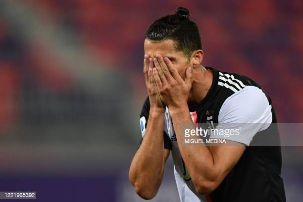 Juventus' Portuguese forward Cristiano Ronaldo reacts after missing a goal opportunity during the Italian Serie A football match Bologna vs Juventus...