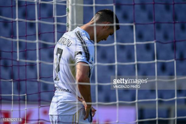 Juventus' Portuguese forward Cristiano Ronaldo reacts after missing a goal opportunity during the Italian Serie A football match Fiorentina vs...
