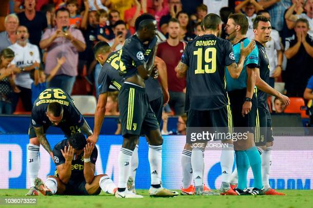 Juventus' Portuguese forward Cristiano Ronaldo reacts after receiving a red card during the UEFA Champions League group H football match between...