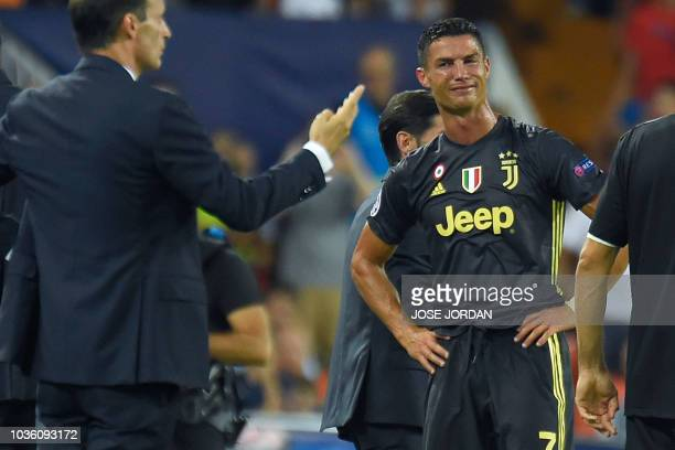 TOPSHOT Juventus' Portuguese forward Cristiano Ronaldo reacts after receiving a red card during the UEFA Champions League group H football match...