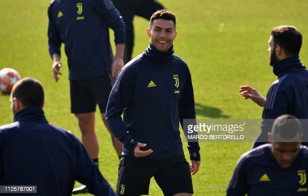 Juventus' Portuguese forward Cristiano Ronaldo reacts during a training session at the Continassa training ground in Turin on February 19 on the eve...