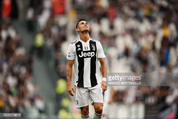 Juventus' Portuguese forward Cristiano Ronaldo reacts during the Italian Serie A football match Juventus vs Lazio on August 25 2018 at the Allianz...