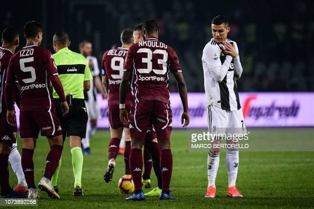 Juventus' Portuguese forward Cristiano Ronaldo reacts during the Italian Serie A football match Torino vs Juventus on December 15 2018 at the Olympic...