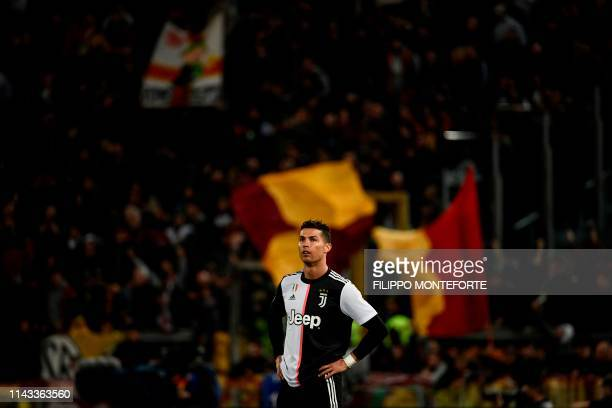 TOPSHOT Juventus' Portuguese forward Cristiano Ronaldo reacts during the Italian Serie A football match between AS Roma and Juventus Turin at the...