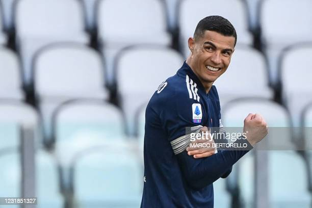 Juventus' Portuguese forward Cristiano Ronaldo reacts during the Italian Serie A football match Juventus Turin vs Benevento on March 21, 2021 at the...