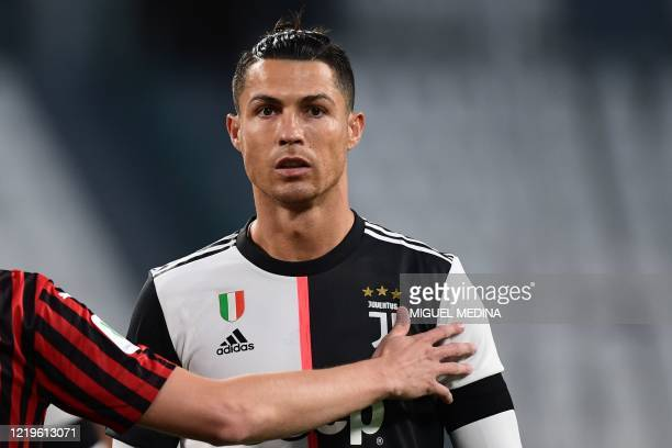Juventus' Portuguese forward Cristiano Ronaldo reacts during the Italian Cup semi-final second leg football match Juventus vs AC Milan on June 12,...