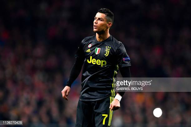 Juventus' Portuguese forward Cristiano Ronaldo reacts during the UEFA Champions League round of 16 first leg football match between Club Atletico de...