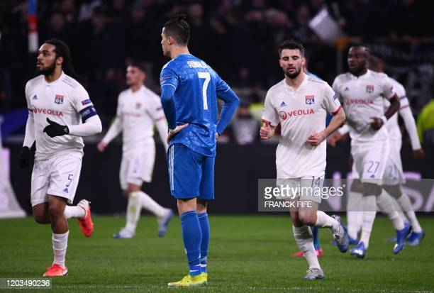 Juventus' Portuguese forward Cristiano Ronaldo reacts during the UEFA Champions League round of 16 first-leg football match between Lyon and Juventus...
