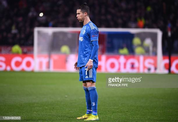 Juventus' Portuguese forward Cristiano Ronaldo reacts during the UEFA Champions League round of 16 firstleg football match between Lyon and Juventus...