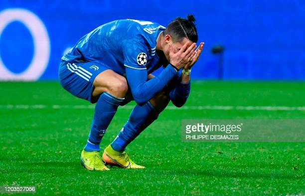 TOPSHOT Juventus' Portuguese forward Cristiano Ronaldo reacts during the UEFA Champions League round of 16 firstleg football match between Lyon and...