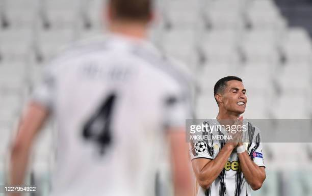 Juventus' Portuguese forward Cristiano Ronaldo reacts during the UEFA Champions League round of 16 second leg football match between Juventus and...