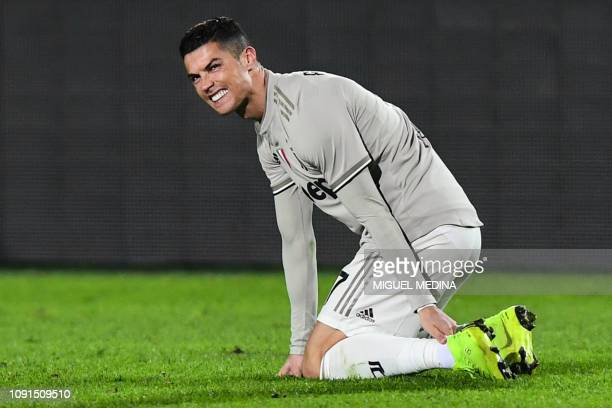 TOPSHOT Juventus' Portuguese forward Cristiano Ronaldo reacts in pain after a shock during the Italian Tim Cup round of eight football match Atalanta...