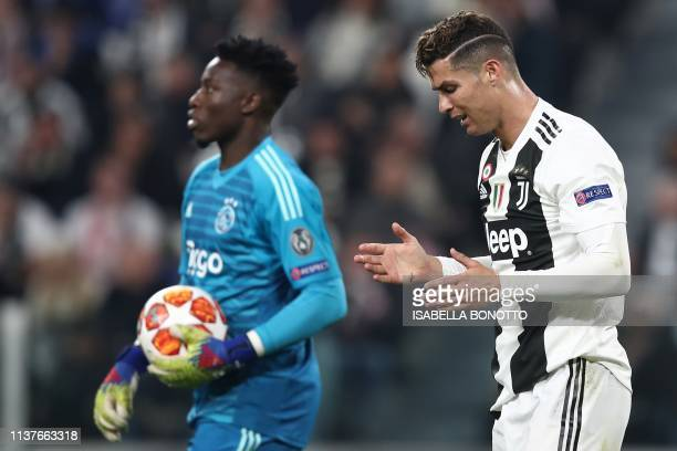 Juventus' Portuguese forward Cristiano Ronaldo reacts next to Ajax's Cameroonian goalkeeper Andre Onana after missing a goal opportunity during the...