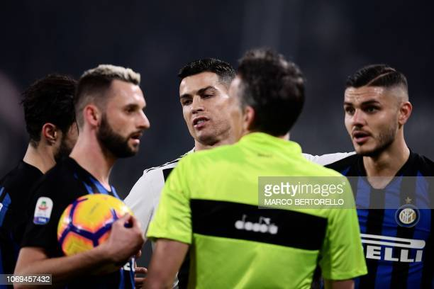 Juventus' Portuguese forward Cristiano Ronaldo reacts next to Inter Milan's Argentine forward Mauro Icardi and Inter Milan's Croatian midfielder...