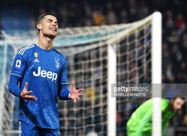 Juventus' Portuguese forward Cristiano Ronaldo reacts reacts after missing a goal opportunity during the Italian Serie A football match SPAL vs...