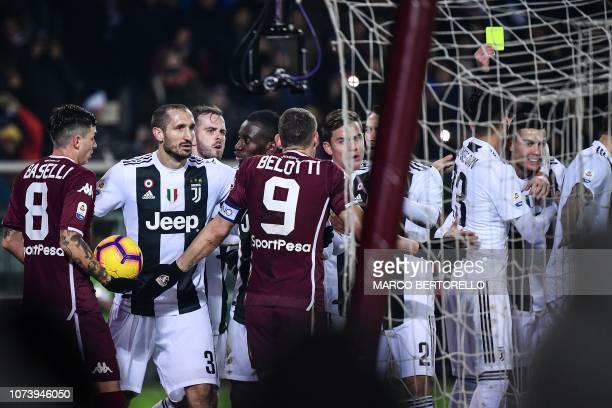 Juventus' Portuguese forward Cristiano Ronaldo receives a yellow card as Torino's Italian midfielder Daniele Baselli and Torino's Italian forward...