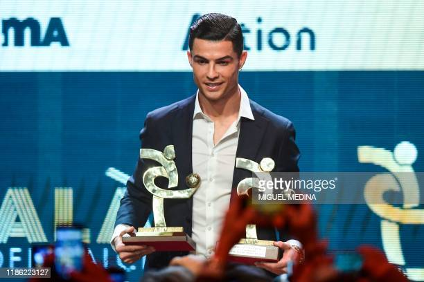 Juventus' Portuguese forward Cristiano Ronaldo receives the award of best player of the year of the Italian championship Serie A during the 'Gran...