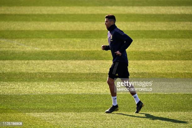 Juventus' Portuguese forward Cristiano Ronaldo runs during a training session at the Continassa training ground in Turin on February 19 on the eve of...