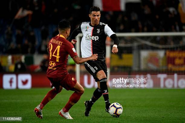 Juventus' Portuguese forward Cristiano Ronaldo runs with ball with AS Roma Dutch forward Justin Kluivert during the Italian Serie A football match...