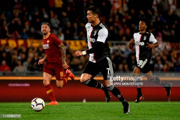Juventus' Portuguese forward Cristiano Ronaldo runs with the ball during the Italian Serie A football match between AS Roma and Juventus Turin at the...