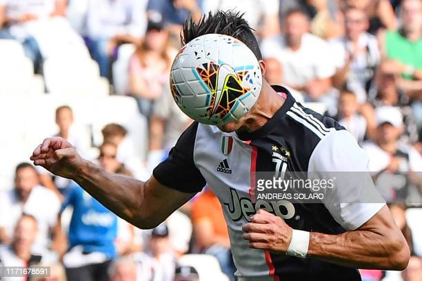 Juventus' Portuguese forward Cristiano Ronaldo scores a header during the Italian Serie A football match Juventus vs Spal on September 28 2019 at the...