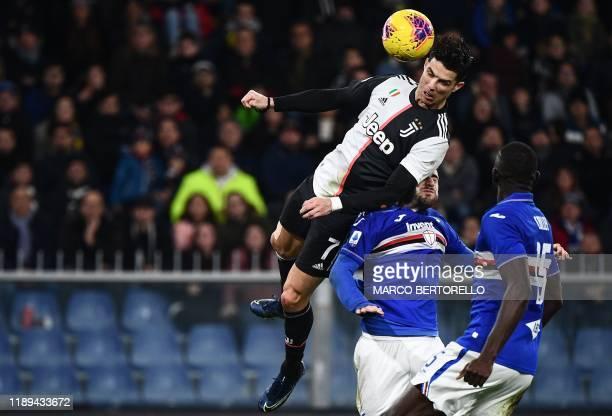 TOPSHOT Juventus' Portuguese forward Cristiano Ronaldo scores a header during the Italian Serie A football match Sampdoria vs Juventus on December 18...