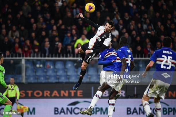 TOPSHOT Juventus' Portuguese forward Cristiano Ronaldo scores a header during the Italian Serie A football match Sampdoria vs Juventus on December 18...