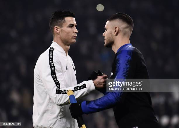 Juventus' Portuguese forward Cristiano Ronaldo shakes hand with Inter Milan's Argentine forward Mauro Icardi prior to the start of the Serie A...