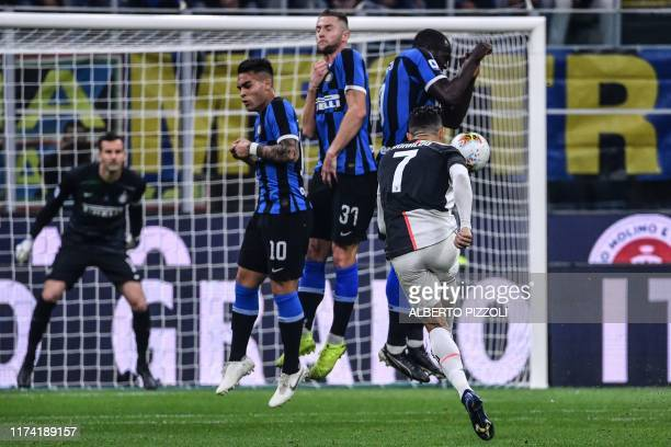 Juventus' Portuguese forward Cristiano Ronaldo shoots a free kick during the Italian Serie A football match Inter vs Juventus on October 6, 2019 at...