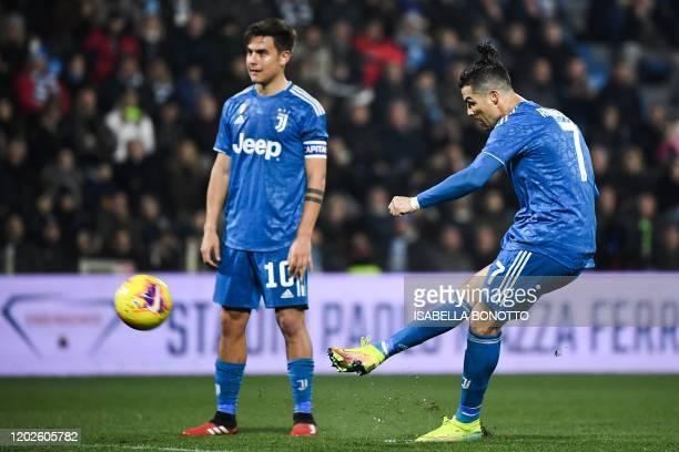 Juventus' Portuguese forward Cristiano Ronaldo shoots a free-kick next to Juventus' Argentine forward Paulo Dybala during the Italian Serie A...