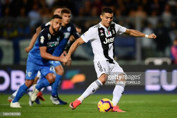 Juventus' Portuguese forward Cristiano Ronaldo shoots a penalty kick and scores a goal during the Italian Serie A football match between Empoli and...