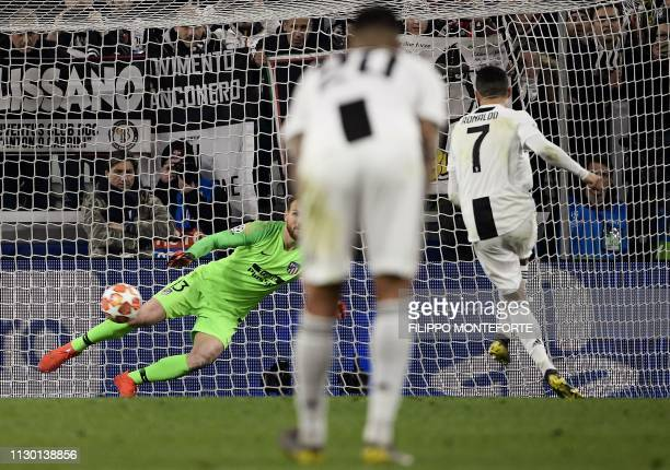 Juventus' Portuguese forward Cristiano Ronaldo shoots a penalty to score 30 during the UEFA Champions League round of 16 secondleg football match...