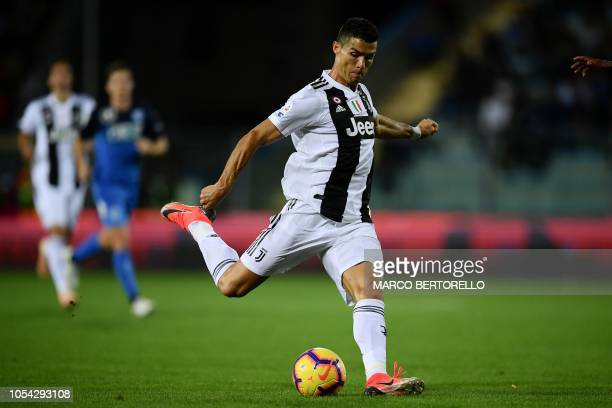 TOPSHOT Juventus' Portuguese forward Cristiano Ronaldo shoots and scores a second goal during the Italian Serie A football match between Empoli and...