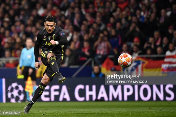 Juventus' Portuguese forward Cristiano Ronaldo shoots during the UEFA Champions League round of 16 first leg football match between Club Atletico de...